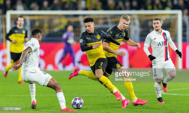 Jadon Sancho and Erling Braut Haaland of Borussia Dortmund are challenged by Presnel Kimpembe of Paris SaintGermain during the UEFA Champions League...