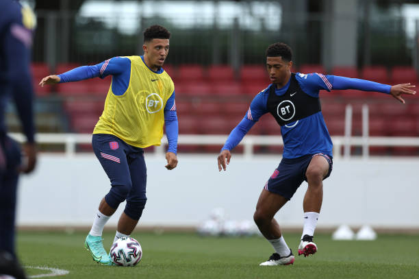 Jadon Sancho and Jude Bellingham of England in action during the England Training Session at St George's Park on June 14, 2021 in Burton upon Trent,...