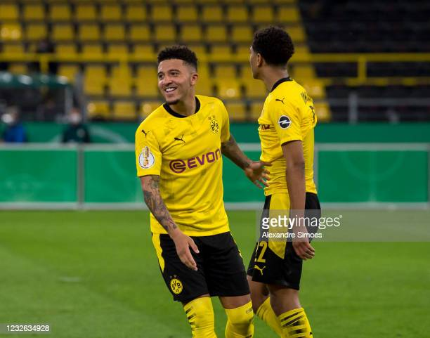 Jadon Sancho and Jude Bellingham react during the match between Borussia Dortmund and Holstein Kiel on May 01, 2021 in Dortmund, Germany.