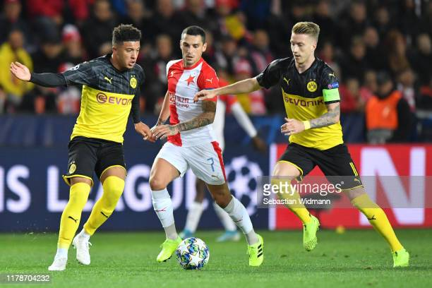 Jadon Sancho and Marco Reus of Borussia Dortmund compete with Nicolae Stanciu of Slavia Praha during the UEFA Champions League group F match between...