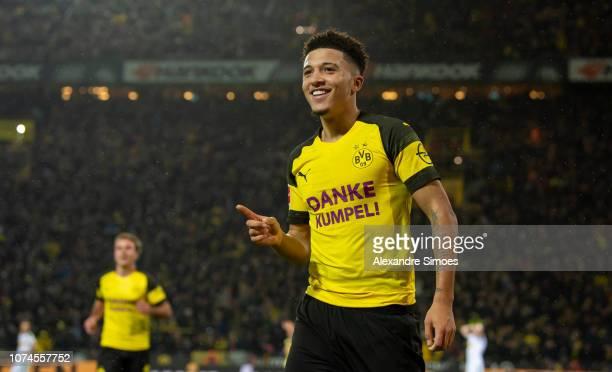 Jadon Sancho celebrates scoring his side's first goal during the Bundesliga match between Borussia Dortmund and Borussia Moenchengladbach at Signal...