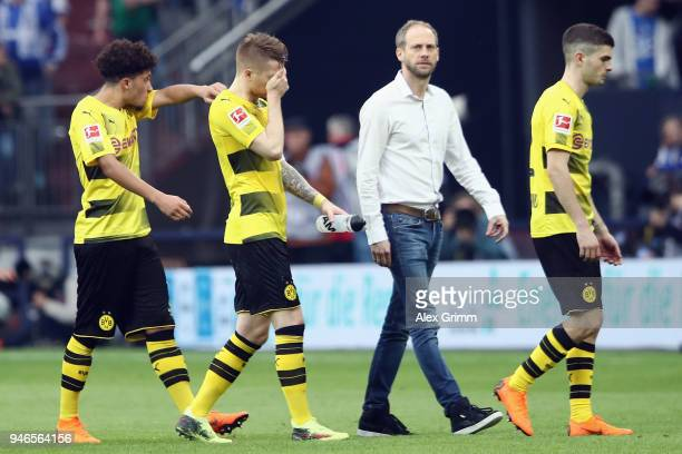 Jadon Sancho Marco Reus and Christian Pulisic of Dortmund react after the Bundesliga match between FC Schalke 04 and Borussia Dortmund at...