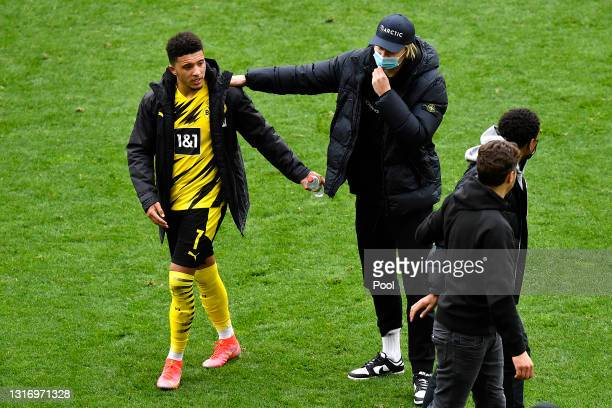 Jadon Sancho of Borussia Dortmund and Erling Haaland of Borussia Dortmund celebrate following their team's victory in the Bundesliga match between...