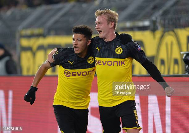 Jadon Sancho of Borussia Dortmund and Julian Brandt of Borussia Dortmund celebrates after scoring his teams second goal with the team mates during...