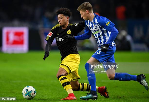 Jadon Sancho of Borussia Dortmund and Mitchell Weiser of Hertha Berlin battle for the ball during the Bundesliga match between Hertha BSC and...
