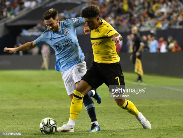 Jadon Sancho of Borussia Dortmund and Patrick Roberts of Manchester City go for the ball on July 20 2018 at Soldier Field in Chicago Illinois...