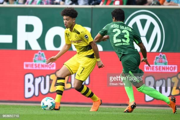 Jadon Sancho of Borussia Dortmund and Theodor Gebre Selassie of Werder Bremen compete for the ball during the Bundesliga match between SV Werder...