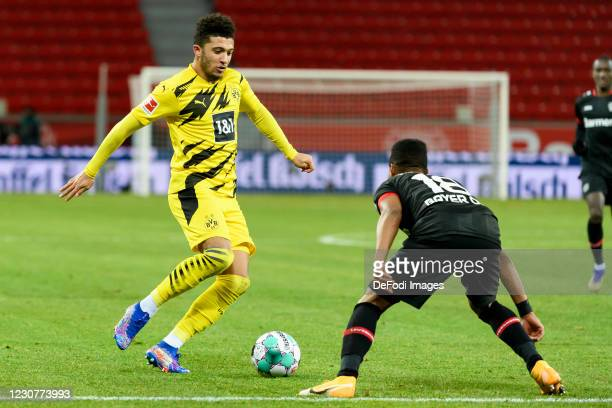 Jadon Sancho of Borussia Dortmund and Wendell of Bayer 04 Leverkusen battle for the ball during the Bundesliga match between Bayer 04 Leverkusen and...