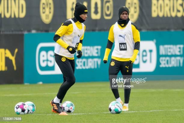 Jadon Sancho of Borussia Dortmund and Youssoufa Moukoko of Borussia Dortmund looks on during the Borussia Dortmund Training Session on January 26,...