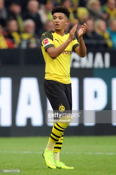 Jadon Sancho of Borussia Dortmund applauds fans as he is substituted off during the Bundesliga match between Borussia Dortmund and Hertha BSC at...