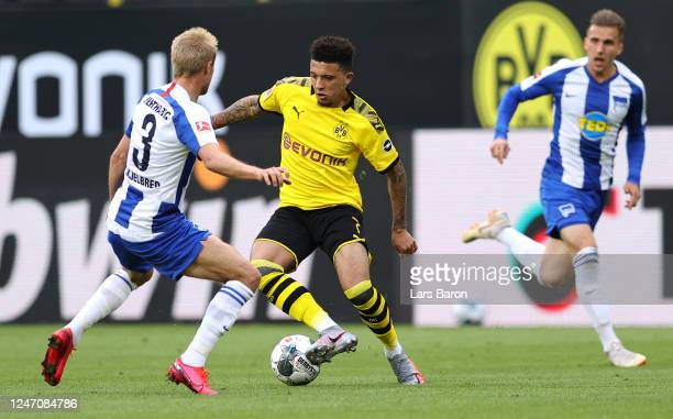 Jadon Sancho of Borussia Dortmund battles for the ball with Per Ciljan Skjelbred of Hertha BSC during the Bundesliga match between Borussia Dortmund...