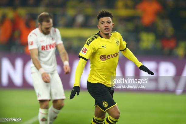 Jadon Sancho of Borussia Dortmund celebrates after he scores his sides third goal during the Bundesliga match between Borussia Dortmund and 1 FC...