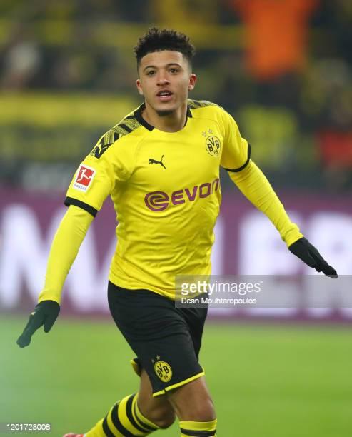 Jadon Sancho of Borussia Dortmund celebrates after he scores his sides third goal during the Bundesliga match between Borussia Dortmund and 1 FC...