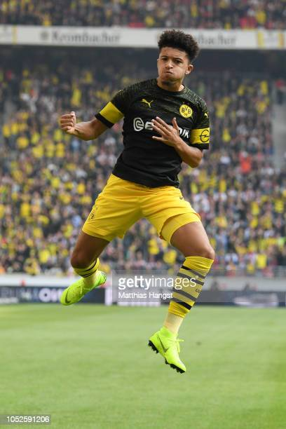 Jadon Sancho of Borussia Dortmund celebrates after scoring his team's first goal during the Bundesliga match between VfB Stuttgart and Borussia...