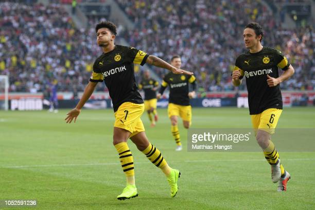 Jadon Sancho of Borussia Dortmund celebrates after scoring his team's first goal with Thomas Delaney of Borussia Dortmund during the Bundesliga match...