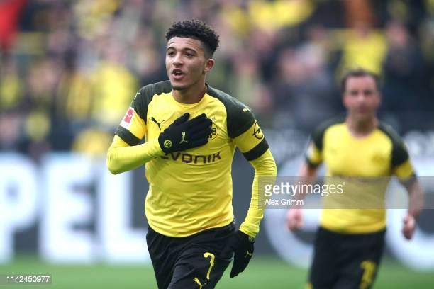 Jadon Sancho of Borussia Dortmund celebrates after scoring his team's first goal during the Bundesliga match between Borussia Dortmund and 1 FSV...