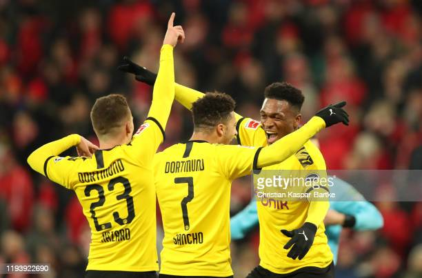 Jadon Sancho of Borussia Dortmund celebrates after scoring his team's second goal with Dan-Axel Zagadou and Thorgan Hazard of Borussia Dortmund...