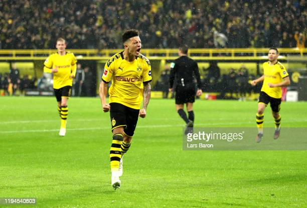 Jadon Sancho of Borussia Dortmund celebrates after scoring his team's third goal during the Bundesliga match between Borussia Dortmund and RB Leipzig...