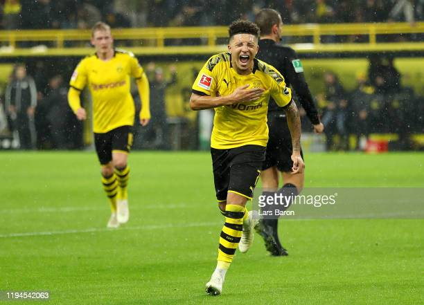 Jadon Sancho of Borussia Dortmund celebrates after scoring his team's third goal during the Bundesliga match between Borussia Dortmund and RB Leipzig...