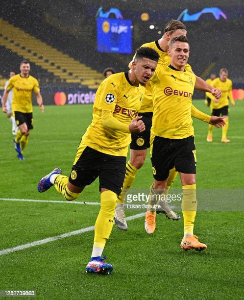 Jadon Sancho of Borussia Dortmund celebrates after scoring his team's first goal from the penalty spot during the UEFA Champions League Group F stage...