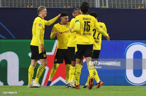 Jadon Sancho of Borussia Dortmund celebrates after scoring their sides first goal with Erling Haaland and Manuel Akanji during the UEFA Champions...