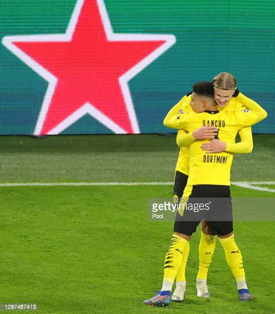 Jadon Sancho of Borussia Dortmund celebrates after scoring their sides first goal with Erling Haaland during the UEFA Champions League Group F stage...