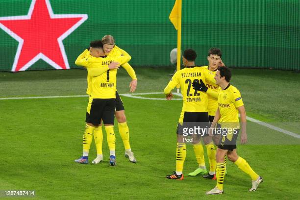 Jadon Sancho of Borussia Dortmund celebrates after scoring their sides second goal with Erling Haaland during the UEFA Champions League Group F stage...