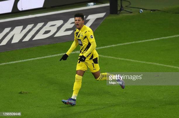 Jadon Sancho of Borussia Dortmund celebrates after scoring their team's first goal during the Bundesliga match between RB Leipzig and Borussia...