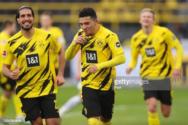 Jadon Sancho of Borussia Dortmund celebrates after scoring their side's second goal from the penalty spot during the Bundesliga match between...