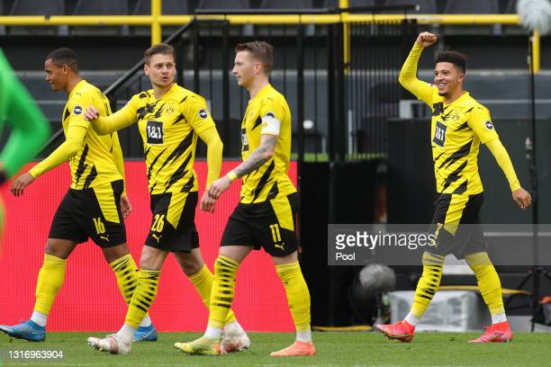 Jadon Sancho of Borussia Dortmund celebrates after scoring their side's second goal during the Bundesliga match between Borussia Dortmund and RB...