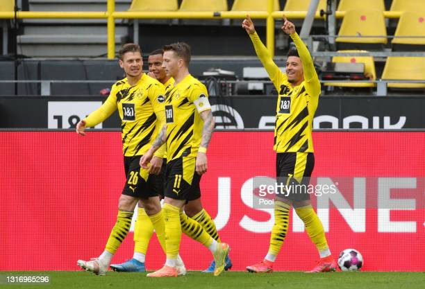 Jadon Sancho of Borussia Dortmund celebrates after scoring their team's second goal during the Bundesliga match between Borussia Dortmund and RB...