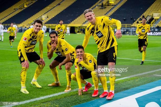 Jadon Sancho of Borussia Dortmund celebrates scoring his goal to the 2:0 with his team mates during the Bundesliga match between Borussia Dortmund...