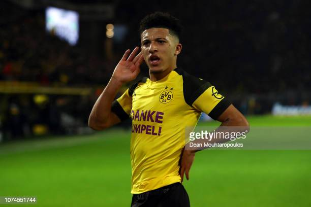 Jadon Sancho of Borussia Dortmund celebrates scoring his side's first goal during the Bundesliga match between Borussia Dortmund and Borussia...