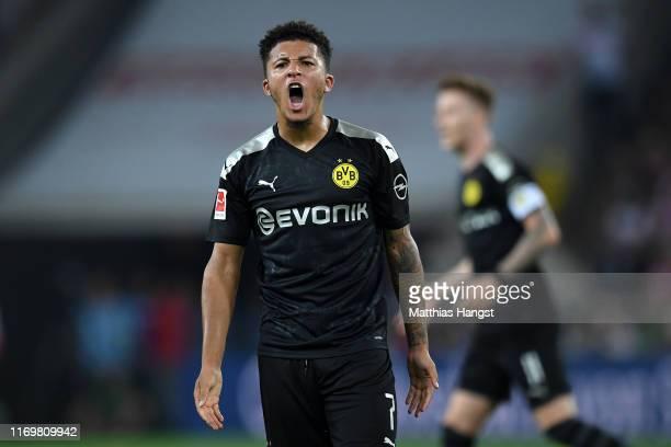 Jadon Sancho of Borussia Dortmund celebrates scoring his side's first goal during the Bundesliga match between 1 FC Koeln and Borussia Dortmund at...