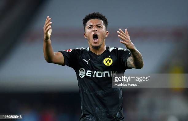 Jadon Sancho of Borussia Dortmund celebrates scoring his side's first goal during the Bundesliga match between 1. FC Koeln and Borussia Dortmund at...