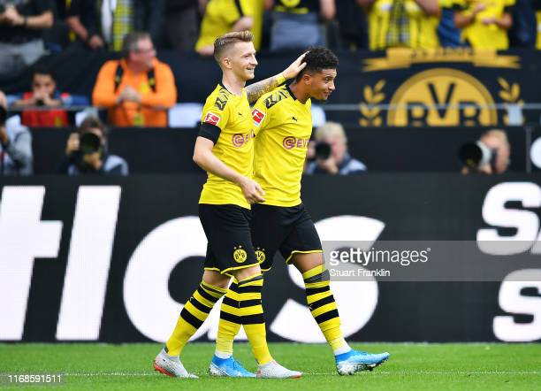 Jadon Sancho of Borussia Dortmund celebrates scoring his sides second goal during the Bundesliga match between Borussia Dortmund and FC Augsburg at...