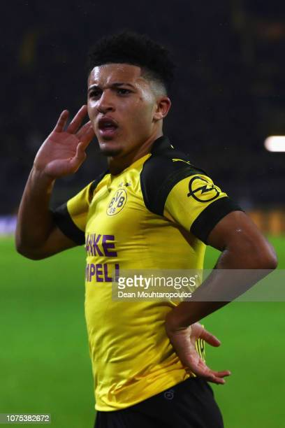 Jadon Sancho of Borussia Dortmund celebrates scoring his teams first goal of the game during the Bundesliga match between Borussia Dortmund and...