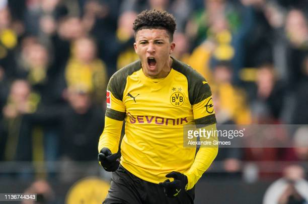 Jadon Sancho of Borussia Dortmund celebrates scoring the opening goal during the Bundesliga match between Borussia Dortmund and 1 FSV Mainz 05 at the...