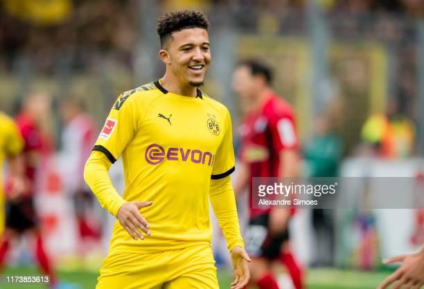 Jadon Sancho of Borussia Dortmund celebrates the goal to the 12 during the Bundesliga match between SportClub Freiburg and Borussia Dortmund at the...
