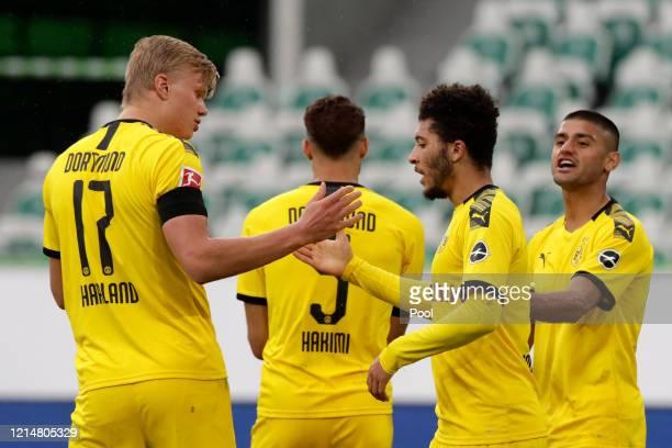 Jadon Sancho of Borussia Dortmund celebrates with Erling Haaland after Achraf Hakimi scored their side's second goal during the Bundesliga match...