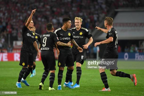 Jadon Sancho of Borussia Dortmund celebrates with his team mates after scoring his side's first goal during the Bundesliga match between 1 FC Koeln...