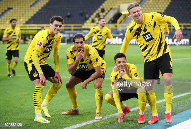 Jadon Sancho of Borussia Dortmund celebrates with team mates Giovanni Reyna, Emre Can and Erling Haaland after scoring their side's second goal...