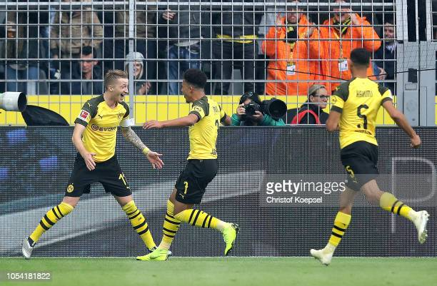 Jadon Sancho of Borussia Dortmund celebrates with teammare Marco Reus after scoring his team's first goal which is then disallowed during the...