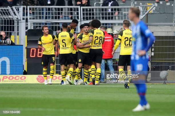 Jadon Sancho of Borussia Dortmund celebrates with teammates after scoring his team's first goal during the Bundesliga match between Borussia Dortmund...