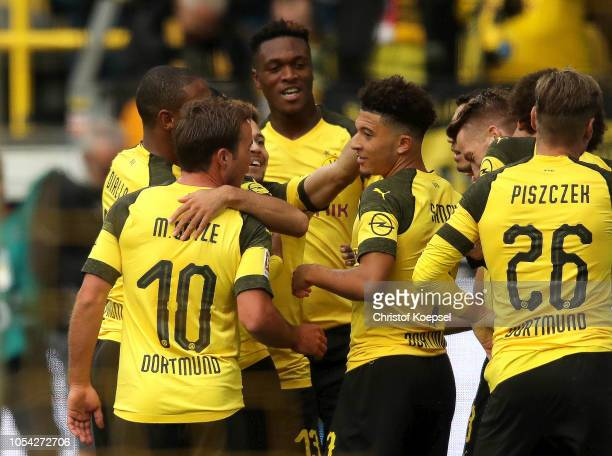 Jadon Sancho of Borussia Dortmund celebrates with teammates after scoring his team's second goal during the Bundesliga match between Borussia...