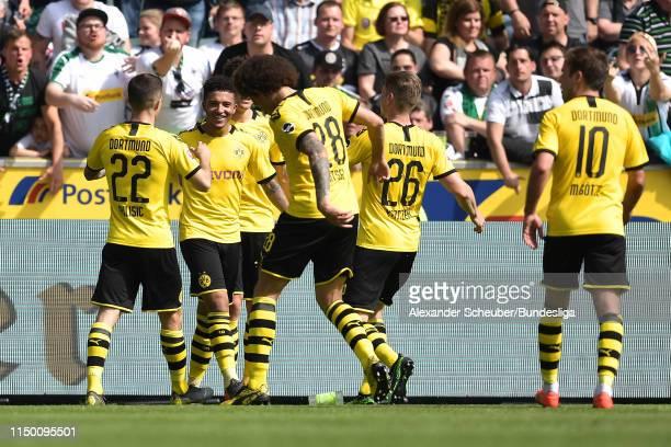 Jadon Sancho of Borussia Dortmund celebrates with teammates after scoring his team's first goal during the Bundesliga match between Borussia...