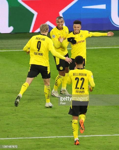 Jadon Sancho of Borussia Dortmund celebrates with teammates Manuel Akanji Erling Haaland and Jude Bellingham after scoring their team's second goal...