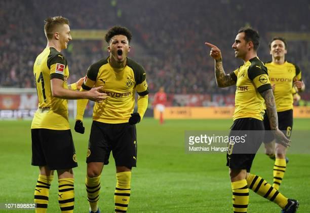 Jadon Sancho of Borussia Dortmund celebrates with teammates Marco Reus of Borussia Dortmund and Paco Alcacer of Dortmund during during the Bundesliga...