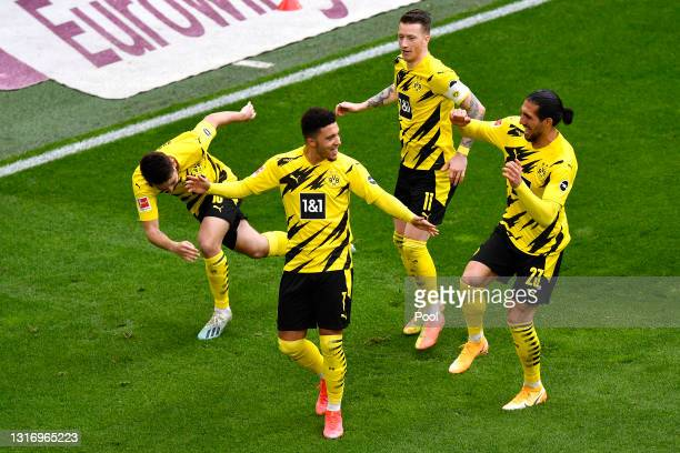 Jadon Sancho of Borussia Dortmund celebrates with Thorgan Hazard, Marco Reus and Emre Can after scoring their team's second goal during the...