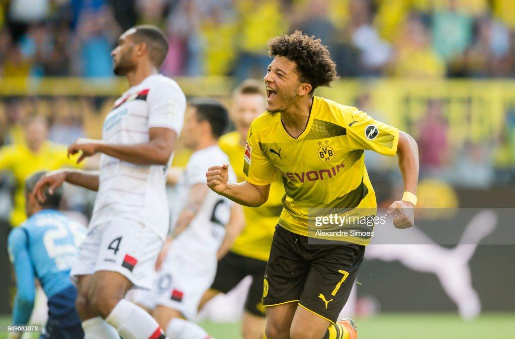 Jadon Sancho of Borussia Dortmund cheers after scoring his team's 1st goal during the Bundesliga match between Borussia Dortmund and Bayer 04 Leverkusen at Signal Iduna Park on April 21, 2018 in Dortmund, Germany.